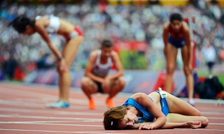 epa03339998 Ukrainian runner Valentyna Horpynych Zhudina (foreground) and fellow competitors are exhausted after the women's 3000m Steeplechase heats at the London 2012 Olympic Games Athletics, Track and Field events at the Olympic Stadium, London, Britain, 04 August 2012.  EPA/JOHN MABANGLO